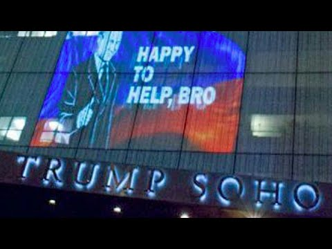 """Be brave, bro!"" huge projection depicting Putin appears on Trump"