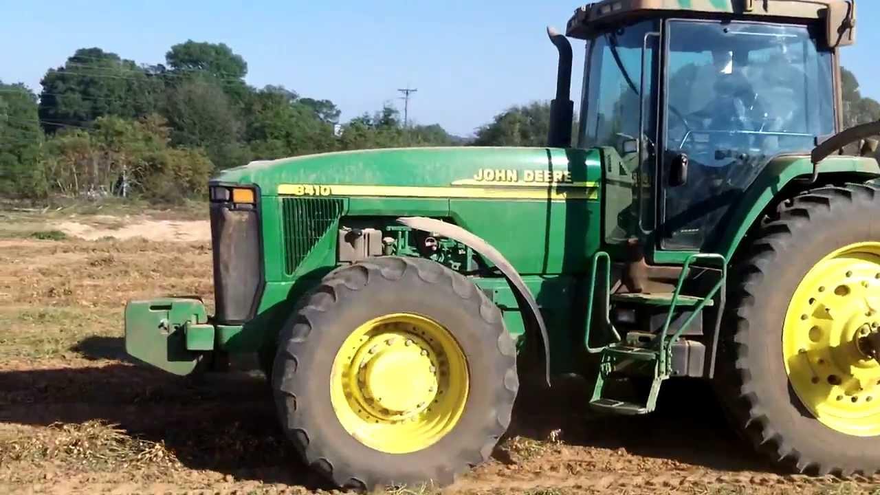 John deere 8410 tractor pulling a kmc peanut picker for 8410 3