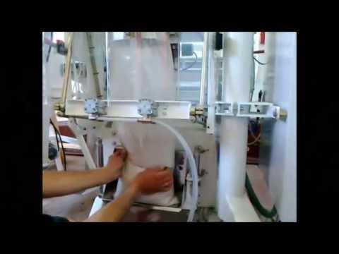 Фасовка и упаковка костной муки в мешки по 10 кг автоматическим оборудованием