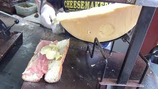 New York Street Food. Yummi French Raclette. Ham, Hot Dog, Sausage with Soft Warm Cheese