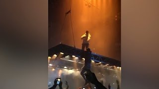 kanye west fan grabs hold of floating stage during pablo tour