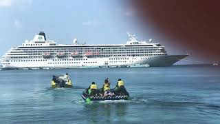 Water tubing near cruise ship in the ocean