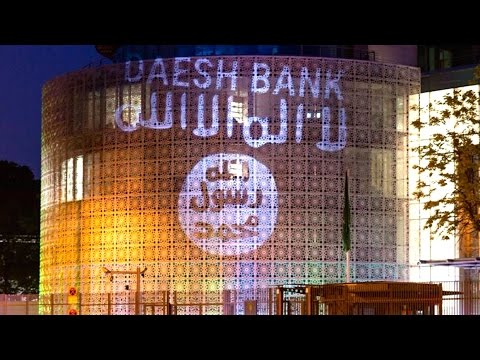 ISIS Flag Projected on Saudi Embassy With Words 'Daesh Bank'