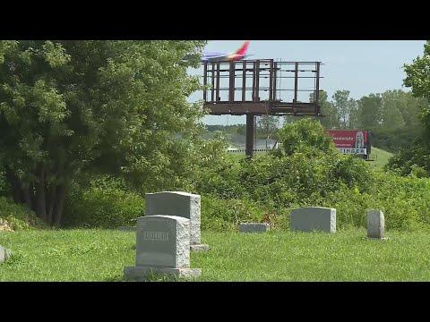 Billboards Start Coming Down Near Washington Park Cemetery After Year-long Court Battle