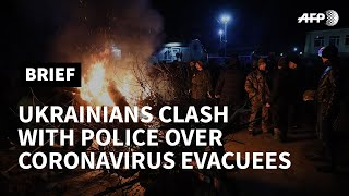 Ukraine protesters clash with police over China virus evacuees | AFP