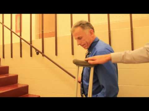 How to go up/down stairs with crutches and a rail - YouTube