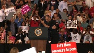 Trump brings supporter on stage during rally