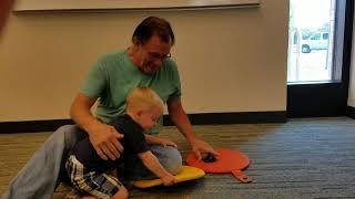 Vincent and Papa at library Story time - 2 yo