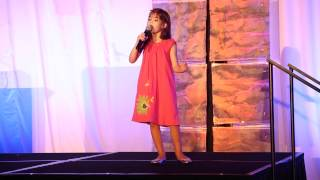 Kaitlyn Maher (at 8 years old) sings the song she co-wrote when she...