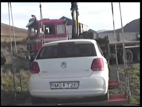 Heavy-Duty Tow Iceland Crane Truck picks up a small car