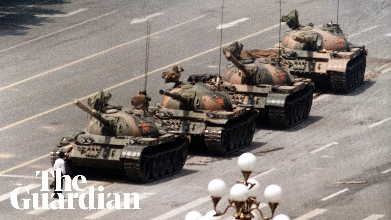 Tank Man: hero of 1989 Tiananmen protest stands in front of tanks – archive video