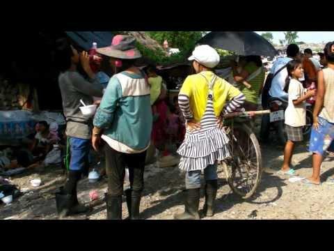 "Angels on a dump site - Mae Sot, Thailand - Meeting monk ""King Zero"""