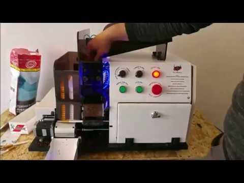 Автоматический станок для набивки табака в гильзы, производство сигарет.