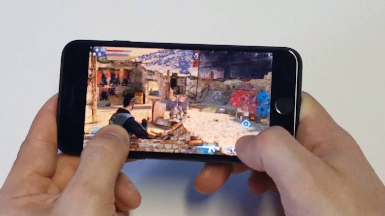 Image result for person playing games on iPhone