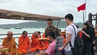 Chinese families mourn loved ones who died in Thai tourist boat tragedy