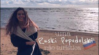 Caçando cogumelos, praia e telhados russos