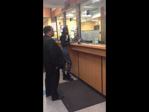 Black lady goes crazy in a check cashing place and demands money in NYC!
