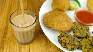 Closeup shot of hands serving hot masala chai with delicious fried Indian snacks