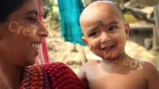 A closeup of an Indian village mother and her cute baby boy