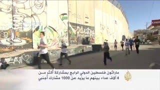 أربعة آلاف عداء بماراثون فلسطين الدولي الرابع