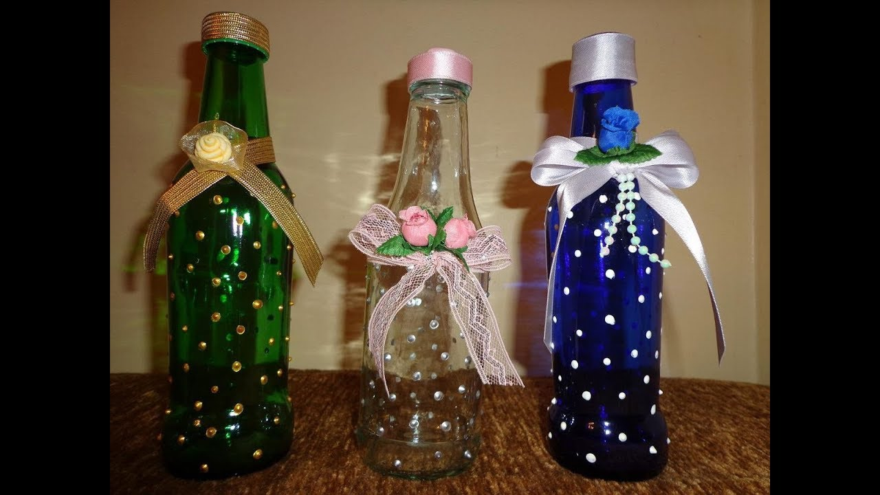 Como decorar una botella de vidrio con tonos dorados - Manualidades con botellas de cristal ...