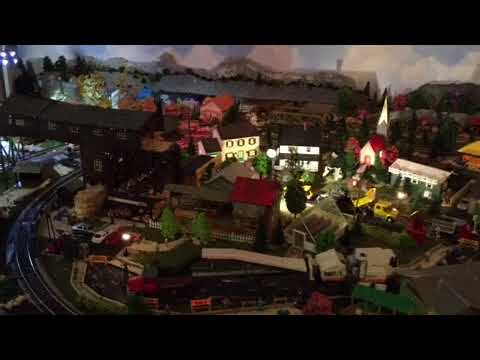Model railroad with track cleaning car running