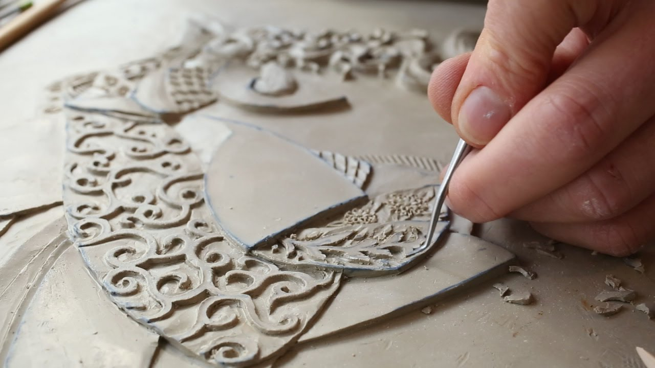 Victoria ellis carves fine bas relief figurative clay for Clay tile mural
