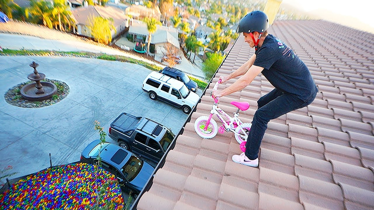 barbie-tricycle-jumped-off-30ft-roof-intoballpit
