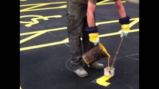 Guy paints handicap symbols
