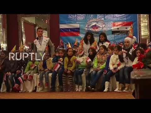 Syria: Russian troops deliver gifts to school children in Aleppo