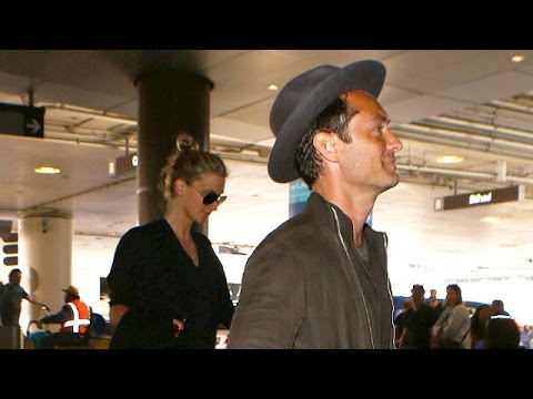 Jude Law And GF Phillipa Coan Arrive At LAX With The Top Down