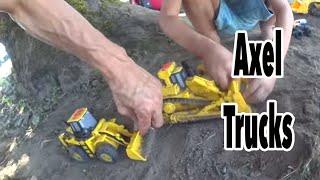 Construction Trucks Make A Monster Truck Ramp