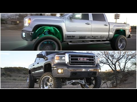 Two 2014 GMC Sierra's 1500's lifted 9 inches on 24x12s ...