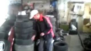 Guy Gets Blown In The Air By An Air Bag In A Tyre