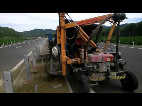 with DTH hammer drilling small hole for highway guardrail pile post