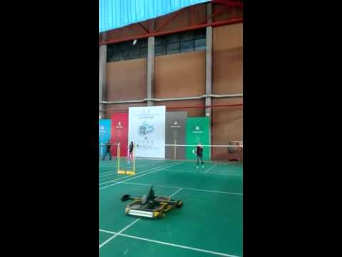 Woman plays badminton with robot in Shenzhen