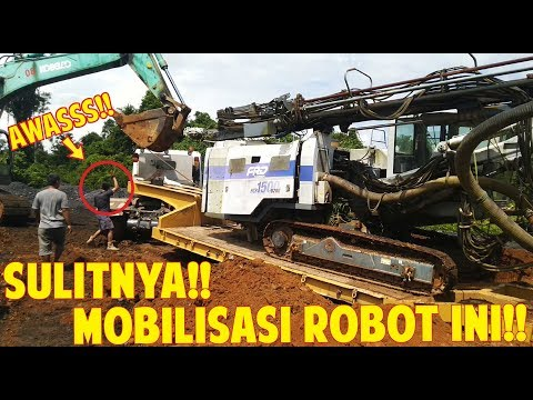 dangerous-!!-the-trouble-pulling-furukawa-rock-drill-above-fuso-supergreat-lowbed-trailer