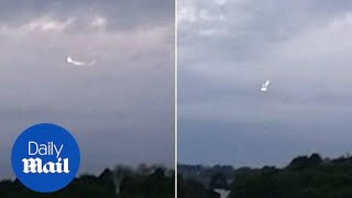 A teen skywatcher claims to have captured a UFO hovering near an RA...