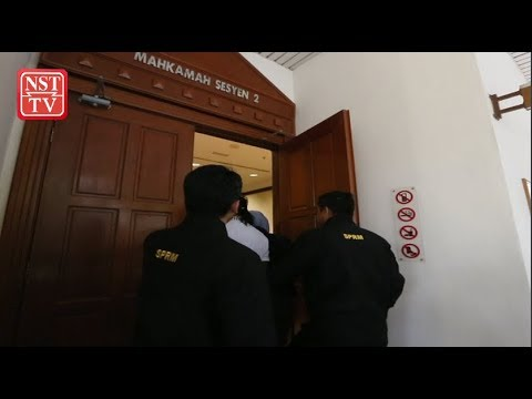 Woman, brother in-law charged with offering bribe to policeman
