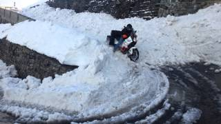 KTM 990 Adventure  plowing through deep snow on Passo dello Stelvio -  Stilfser Joch, 2757 m n.p.m.