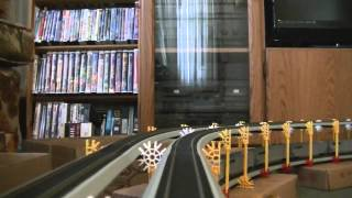3 engine 144 car NS Ho scale train Climbs an inverted dogbone triple layer helix camera ride.
