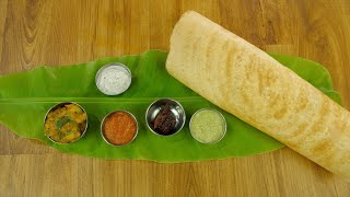 Top view shot of a big plain dosa served over a banana leaf on a wooden platform