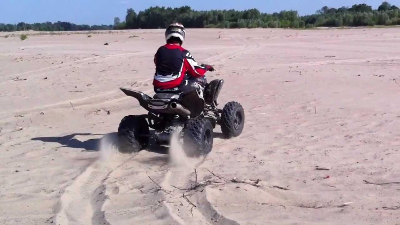Riding Yamaha Raptor  On A Beach