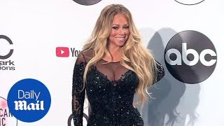 Mariah Carey wows putting on a busty display  after the AMAs
