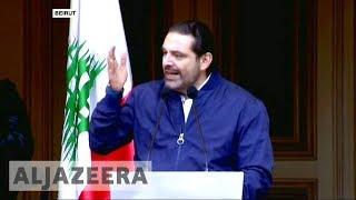 Lebanon's PM Saad Hariri holds off resignation