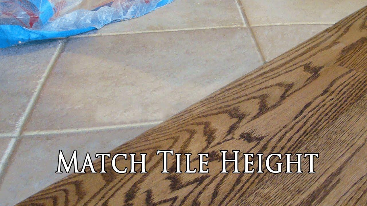 match hardwood floor with tile height