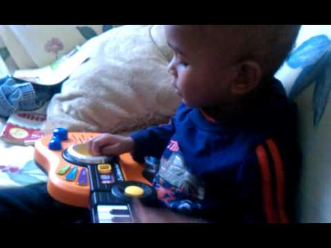 Jayden playing his guitar, piano, drum