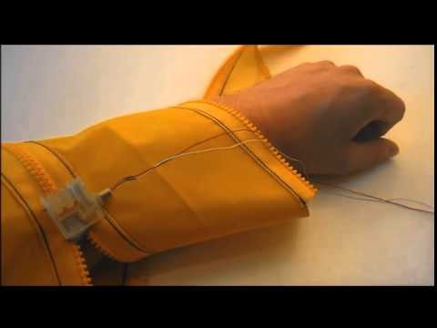This tiny wearable robot can zip your jacket for you