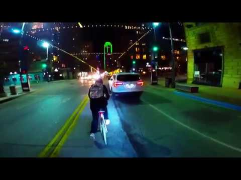 Bicycle ride through downtown Dallas, Texas at night
