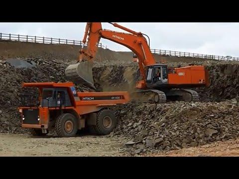 Hitachi ZX 870 LCH excavator at work loading Hitachi EH1100 dump trucks